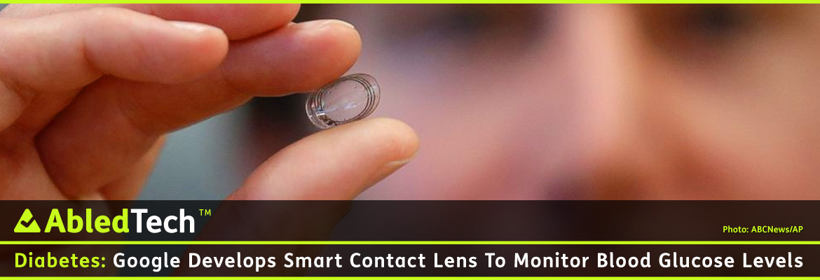AbledTech Post Banner shows a photo of Brian Otis, Google X project lead, holding a contact lens Google is testing to explore tear glucose in Mountain View, Calif. The lens is clear with a 3 band circular ring of gold-colored circuitry connected to a square silicon chip.