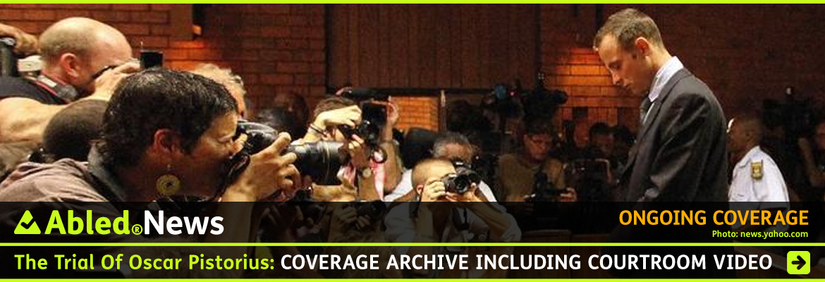 AbledNews-post link banner shows a side view of Oscar Pistorius facing a bank of press cameras in the Gauteng High Court in Pretoria, South Africa. He is wearing a suit and tie and is dtanding with his head bowed and his hands clasped in front of him. Click here to go to the archive page.