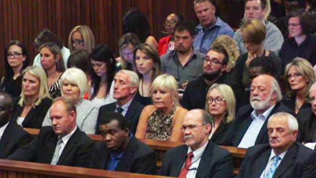 AbledNews photo shows the parents of victim Reeva Steenkamp sitting in the gallery in the courtroom.