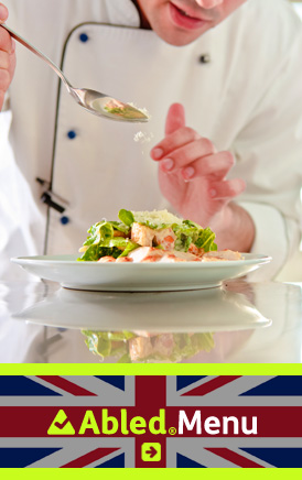 The AbledLondon Menu link banner shows a chef in a white jacket with a black lined off-center lapel sprinkling parmesan cheese onto a Caesar SAlad. Click here to go to the AbledLondon Menu page for a list of restaurants that feature our AbledMenu.