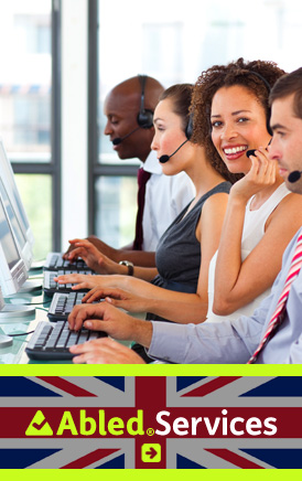 The AbledLondon Services link banner shows a side view of 4 people sitting side-by-side at computers in a call center and wearing headsets. The second woman in is smiling at the camera. Click here to go to the AbledLondon Services page.