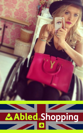 The AbledLondon Shopping link banner shows a 'selfie' taken by British fashion blogger Jordan Bone wearing a fedora hat and sleeveless black top with a fuschia colored Yve St. Laurent handbag and black leggings while sitting in her wheelchair . Click here to go to the AbledLondon Shopping page and learn more about Jordan's Fashion and Beauty blog as well as her advocacy work with young drivers.