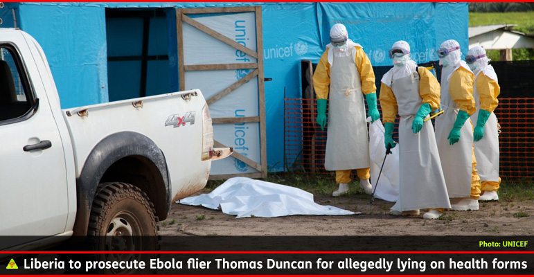 AbledPhoto from UNICEF shows healthcare workers in yellow protective clothing with white protective headgear and turquoise medical gloves standing near the sheet covered body of an Ebola victim in Libera. The caption to the photo reads: Liberia to prosecute EBola flier Thomas Duncan for allegedly lying on health forms.