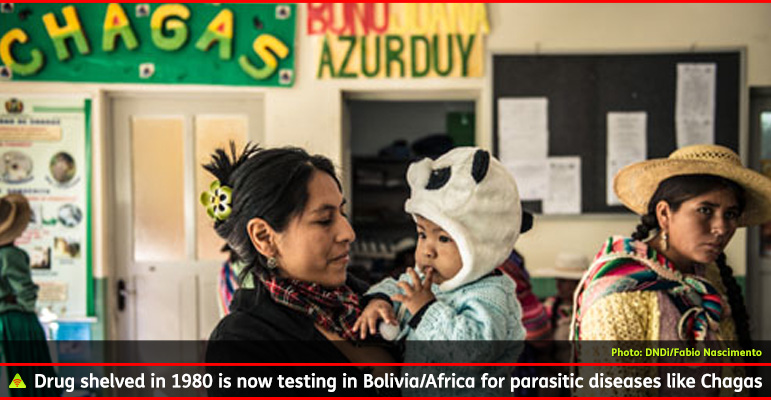 AbledALERT-OUTBREAK-Chagas Photo shows a mother and her daughter and other patients at a health clinic in Bolivia. There is a handmade banner on the wall that says CHAGAS in capital letters and there is a poster showing more information about the disease. The caption reads: Drug shelved in 1980 is now testing in Bolivia/Africa for parasitic diseases like Chagas.