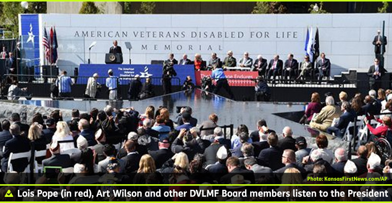 AbledWarriors photo shows a wide shot of the invited audience looking across the star-shaped fountain at the VIP stage where Lois Pope and Art Wilson and other members of their Foundation listen to President Obama's remarks at the dedication of the American Veterans Disabled For Life Memorial in Washington DC.