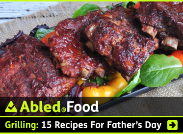 AbledFood: Grilling: 15 recipes for Father's Day. Image: BBQ ribs are set on top of greens and other garnishments.