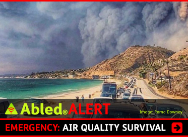 AbledALERT: Emergency: California Wildfires: Air Quality Surivival. Image: Instagram photo taken by actress Roma Downey looking back over traffic on the Pacific Coast Highway as she and other residents of Malibu evacuate the wildfires. The sunny hills and ocean are in stark contrast to the smoke filled sky.