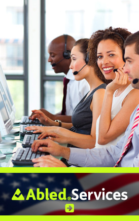 AbledServices link banner. Image: A woman in a row of online support services operators smiles at the camera.