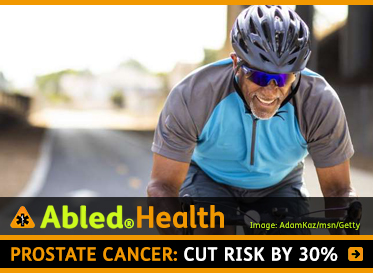 AbledHealth: Prostate Cancer: Cut risk by 30 percent. Image: Middle-aged man wears a helmet as he cycles on a road.