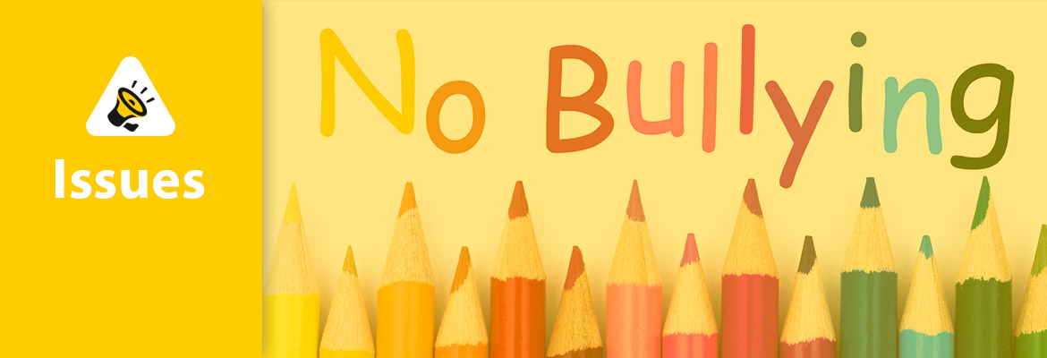 """Abled Issues. Image: Colored pencils are aligned together under the phrase """"No Bullying""""."""