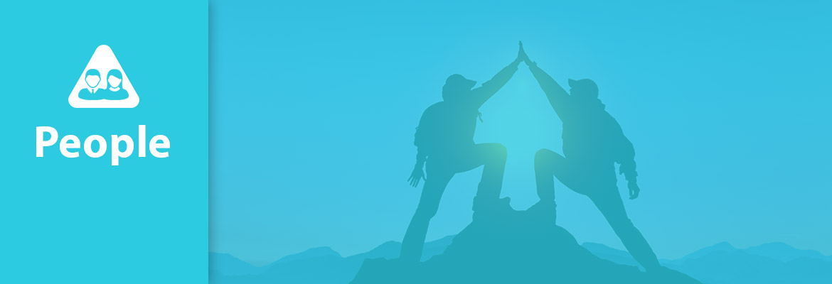 "Abled People. Image: Photo of two people ""high-fiving"" each other at the top of a mountain summit."
