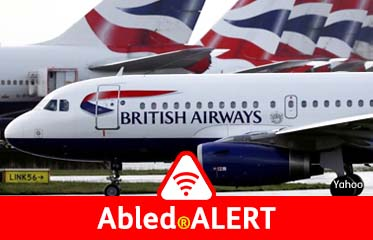 Abled.ALERT: Photo of a British Airways passenger jet taxiing past other parked BA jets at Heathrow Airport outside of London.