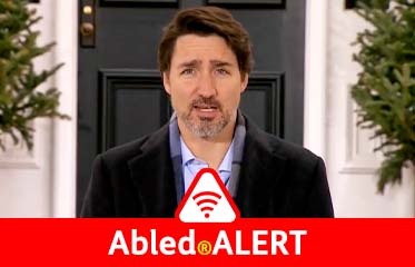 AbledALERT: Video still frame of Canadian Prime Minister Justin Trudeau announcing new domestic travel restrictions for anyone with COVID-19 symptoms.