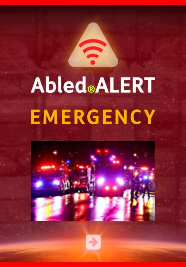 AbledAlert: Emergency. Photo of emergency vehicles with flashing lights at night.