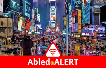 Abled.ALERT: Photo of New York City's Times Square vibrantly lit-up at night.