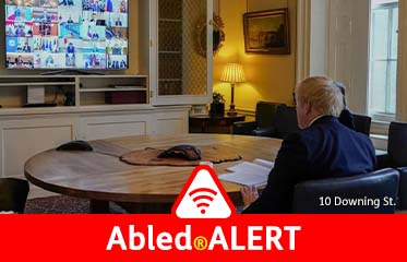 Abled.ALERT: Photo of U.K. Prime Minister working at a circular desk as he looks at a large video screen at Number 10 Downing Street in London as he participates in a global teleconference with G20 leaders.