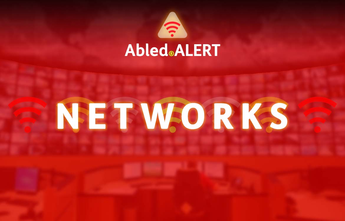 Abled.ALERT Networks banner. Logo and title set against a photo of a large Command and Control Center monitor wall.
