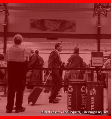 Image of people traveling through an airport.