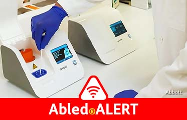 Abled.ALERT: Photo from Abbott Laboratories of a cotton swab being inserted into their testing machine for the coronavirus.