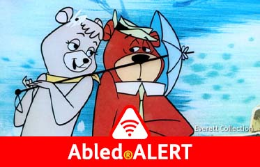 Abled.ALERT: Video frame from a Yogi Bear carton with the character Cindy Bear pulling Yogi closer with an umbrella.