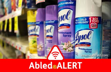 Abled.Alert: Photo of cans of Lysol disinfectant spray on a store shelf.