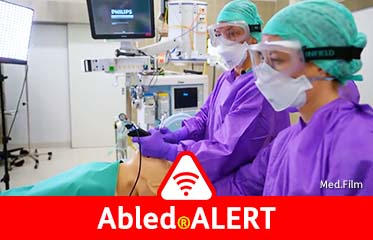 Abled.ALERT: Video still showing an anesthesiologist and an assistant dressed in protective gear intubating a mannequin as a demonstration of what would be done with a COVID-19 patient in respiratory distress.