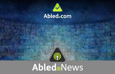 Abled.News: Image of curved monitor wall under the Abled.com logo and above the Abled.News icon which is a circular beacon inside a rounded triangle.