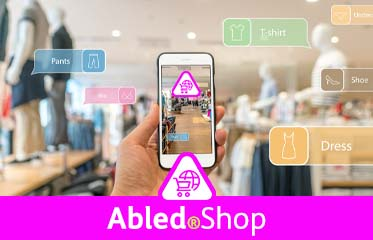 Abled.Shop: Photo illustration of a shopper holding up a smartphone in the foreground with the Abled.Shop app or page open with virtual overlays over a department store scene in the background.