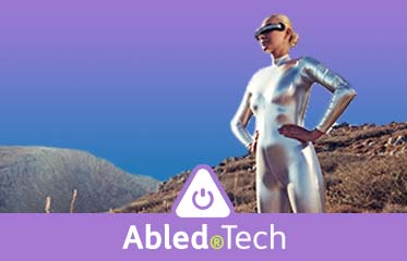 Abled.Tech: Photo illustration shows a woman dressed in a space mylar bodysuit wearing a VR (Virtual Reality) headset outside on a hillside.