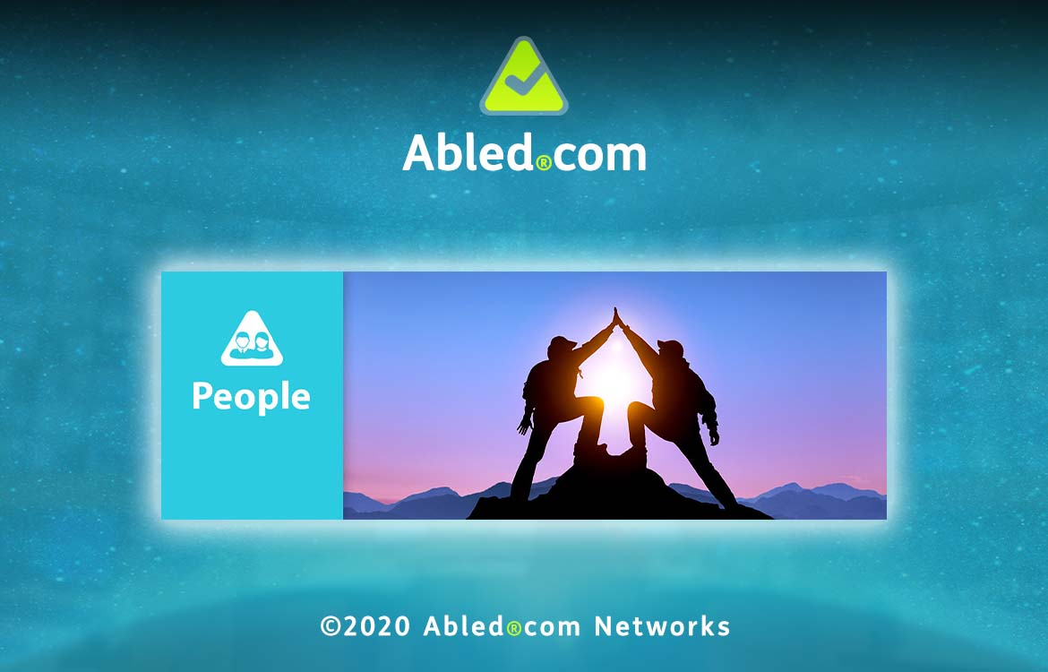 Abled.People Banner. Photo of two people giving each other a high five at the top of a mountain summit with the sun in the background.
