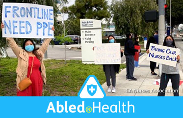 "Abled.Health: Photo shows Nurses protest working conditions outside St. John's Medical Center in Santa Monica, California on Friday, April 17, 2020. One nurse holds up a large sign reading ""Frontline Need PPE"", while another holds a smaller sign reading ""Bring our nurses back""."