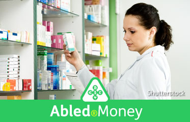 Abled.Money: Stock photo of a pharmacist taking a package of medication from a shelf.