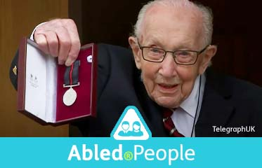 Abled.People: Colonel Tom Moore. The 100 year old UK veteran is pictured holding up a medal for his honorary promotion to Colonel.