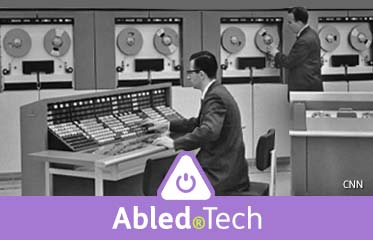Abled.Tech: Black and white photo of two men working with COBOL mainframe computers in the 1960s.