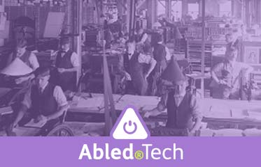 Abled.Tech: Vintage photo of a letterpress printing studio.