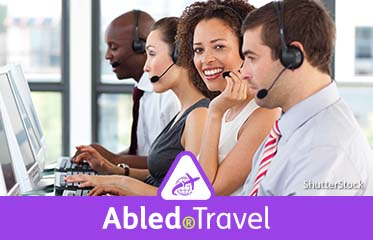 Abled.Travel: Stock photo of customer service operators sitting side by side at computer terminals.