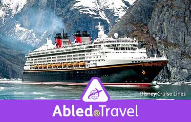 Abled.Travel: Photo of the Disney Cruise Lines ship the Disney Wonder floating among ice with mountains in the background in Alaska.