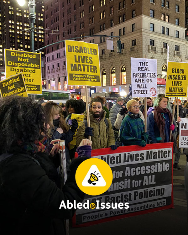 "Abled.Issues Directory link: Photo of people protesting at night in New York City carrying signs that read ""Disabled Lives Matter"" and ""Black Disabled Lives Matter"" along with other signs."