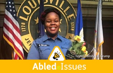 Abled.Issues: Family photo of Breonna Taylor in uniform and holding a bouquet of flowers as the EMT first responder receives an award with the seal of the city of Louisville, Kentucky and the U.S., state and city flags behind her.