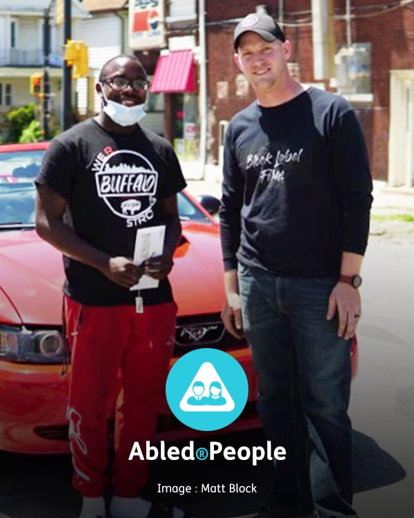 Abled.People: Photo of Matt Block presenting Antonio Gwynn Junior with a red convertible Mustang and a college scholarship in Buffalo, New York.