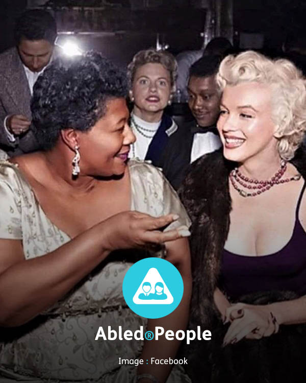 Abled.People: Photo of Ella Fitzgerald and Marilyn Monroe sitting together at the Mocambo nightclub in Los Angeles.