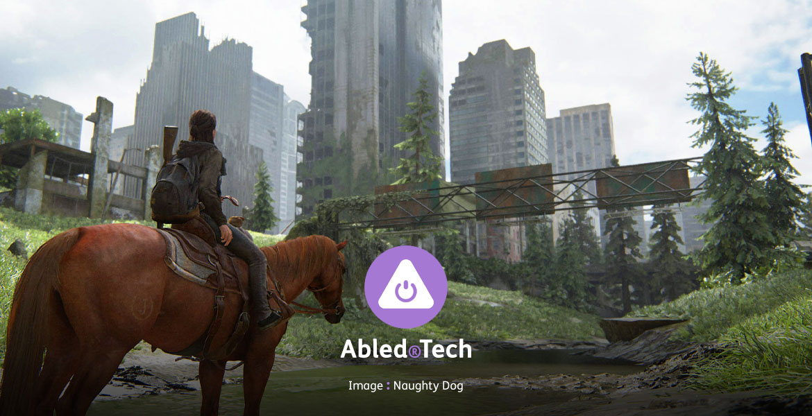 "Abled.Tech: Screen still from the video game ""The Last of Us 2 showing a character sitting on a horse on a grassed-over freeway looking up at a skyline of buildings."