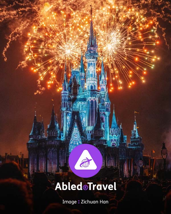 Abled.Travel: Nightime photo of fireworks exploding in the sky behind the Cinderella Castle at Disneyland in California.