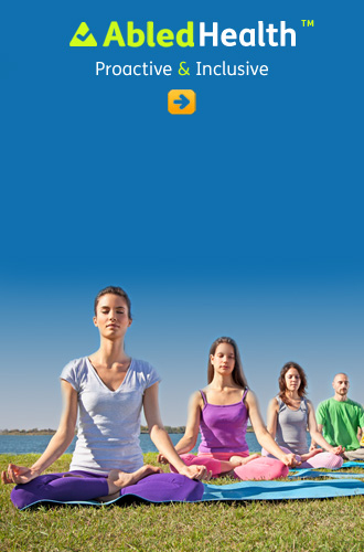 Abledhealth button link shows four people sitting in the lotus position meditating on grass at a lakeshore on a sunny day.