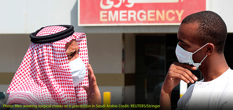 Men wearing surgical masks as a precautionary measure against the novel coronavirus, speak at a hospital in Khobar city in Dammam May 23, 2013. Saudi Arabia has announced another death from the SARS-like novel coronavirus (nCoV) in its central al-Qassim region, bringing the total number of deaths in the kingdom to 17. REUTERS/Stringer