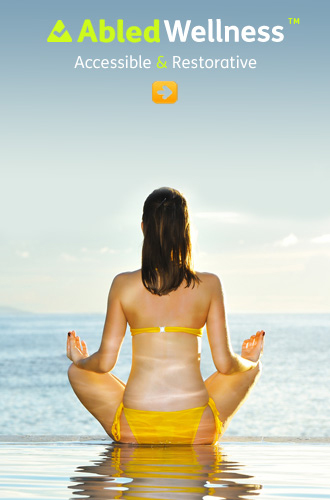 AbledWellness link button shows a young woman in a bikini with her back to the camera sitting in the lotus position meditating at the edge of an infinity pool on the seaside on a sunny day.