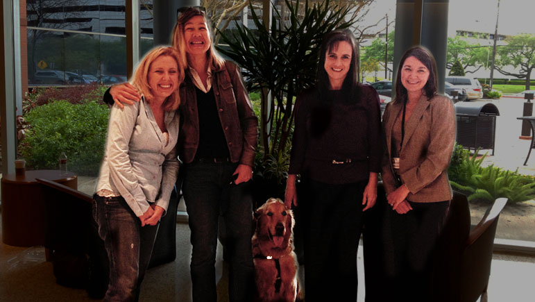 Laura and Wagner have a photo taken at the MD Anderson COoper Lab in Houston, Texas with Dr. Colleen O'Connor, Shelley Robson, MD Anderson's Associate Director of Development whose late dog Dutch was also part of the T-Cell clinical trial, and Sara J. Farris, Senior Communications Specialist with MD Anderson Children's Cancer Hospital.