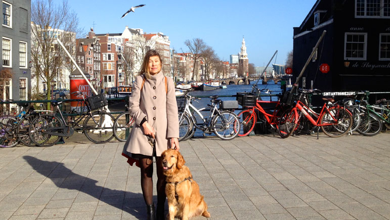 Laura and Wagner pose for a photo on a bridge over one of the canals in Amsterdam before leaving for Texas.