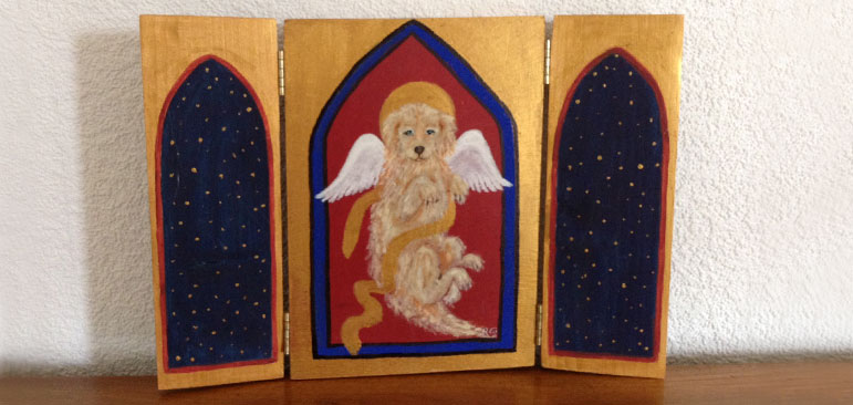 A small wooden 3 panel frame shows a set of arched windows with a painting of Wagner with angel wings and a halo in the center window as created by Laura's friend Juanita Cijntje.