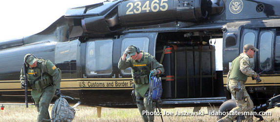 Law enforcement officials disembark a U.S. Customs and Border Patrol helicopter near the town of Cascade in central Idaho to join the search for missing California teen Hannah Anderson.